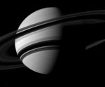 Saturn's rings cutting a sharp shadow across the planet's southern hemisphere